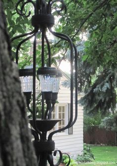 DIY Outdoor Solar Chandelier - use an old chandelier from a thrift store and solar garden stakes from Walmart