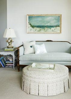 Restful aqua room: driftwood colors, vintage locker basket under table storage.
