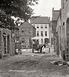 """Charleston, South Carolina, circa 1920. """"Street scene with horse and wagon."""" 4x5 inch nitrate negative by Arnold Genthe."""