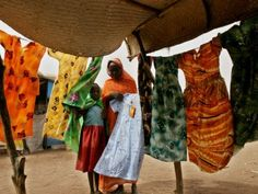 Amazon.com: A Sudanese Woman Buys a Dress for Her Daughter at the Zamzam Refugee Camp Photographic Poster Print, 42x56: Home & Kitchen