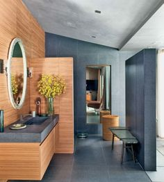John Legend's Bathroom - Singer-songwriter John Legend had the help of designer Don Stewart for the Hollywood home he shares with Christine Teigen. This spacious modern bathroom features a walk in shower and contemporary walnut decor.