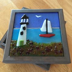"4 1/2"" square soft fused glass tile in a wooden box lid by Kim Natwig."