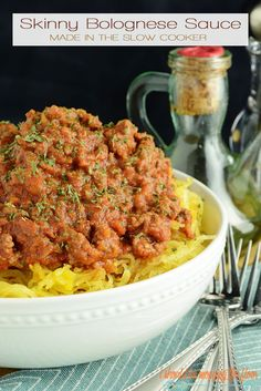 Skinny Slow Cooker Bolognese Sauce   A lightened up version of the classic dish made easy in the slow cooker.   Makes a large batch and freezes beautifully.