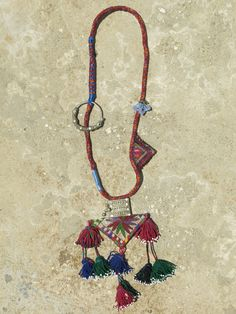 Ethnic necklace with Afghani fabric amulet as centerpiece and tassels