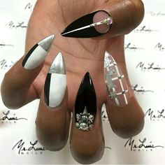 Black white and silver geometric stiletto nails with gems