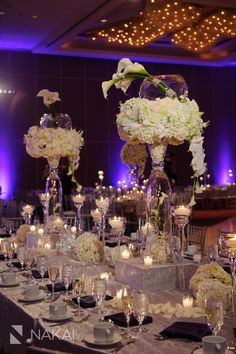 Chicago Wedding Photographer: Nakai Photography - Wedding Reception Venue: Hyatt Regency OHare. Purple uplighting and white flowers. Centerpieces and Flowers by Yanni Design Studio. Coordinator: Oliveaire Artisan Events and Meetings. Sikh + Hindu wedding ceremonies. http://www.nakaiphotography.com