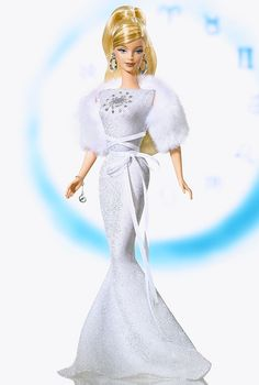 Cancer Barbie® Doll  --  Inspired by the twelve astrological signs, Barbie® doll, represents the mystique and on-going appeal of the zodiac. Each of the twelve glamorous Barbie® dolls in the collection wears a classic gown and faux fur stole. Each gown is decorated with the symbol for its sign with faux rhinestones. Bracelet with zodiac charm and earrings complete the ensemble.
