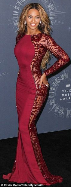Flawless: The star wore a fitted dark pink frock that featured sequined sleeves Beyonce Knowles Zuhair Murad Fall 2014