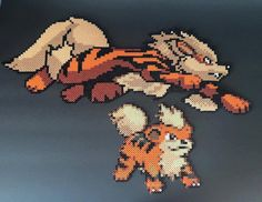 Arcanine and Growlithe Pokemon Perler Bead by RatedEforEveryone
