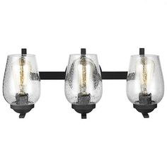 FREE SHIPPING. Purchase the industrial 3 light vanity Morill Bath Light in Blacksmith with Clear Seedy Glass to bring the black hardware trend into your bathroom today at lightingconnection.com. Sea Gull Lighting 4427802-839