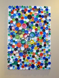 recycle craft: bottle cap collage - what a wonderful pop of color for a kids room or den!