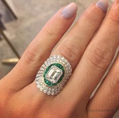 A bespoke Daisy Ring with a central emerald-cut diamond by Jessica McCormack