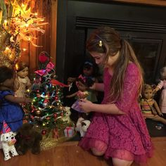 Eva loved decorating the AG Christmas tree. We got the tree at a craft store for $10, plus we had discount coupons. We got two strands of mini, battery powered lights from Walmart for less than $10. We made some decorations and scavenged around the house for the others! #joytoeverygirl