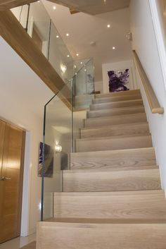 An ultra-modern style which pairs beautifully with oak. Frameless glass eliminat… An ultra-modern style which pairs beautifully with oak. Frameless glass eliminates the need for newel posts and is available with or without a handrail. House Staircase, Interior Staircase, Open Staircase, Staircase Ideas, Staircase Remodel, Interior Architecture, Spiral Staircases, Oak Stairs, Glass Stairs