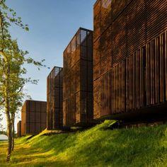 Mont-de-Marsan education centre comprises  wooden boxes hovering over a forest floor