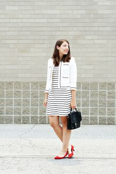 striped dress, tipped white jacket, red shoes