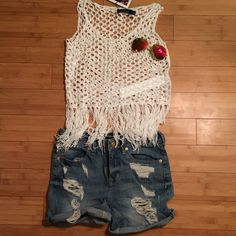 """MINKPINK Castles Made of Sand Knit Tank This tank is NWT! It is a white open knit crop top with fringe at the bottom. It is approximately 15 1/2"""" across the bust when laid flat and 17"""" from shoulder to hem and 24"""" from shoulder to end of fringe. It is 100% acrylic. Please Note:  Top modeled is the XS. MINKPINK Tops Tank Tops"""