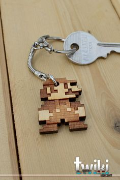 Laser cut and engraved Mario Bros 8bit wood keyring - via Etsy seller TwikiConcept