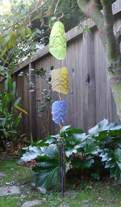 Sun Catcher Chime	This wind chime is art and music at the same time. The art glass comes in several colors and is really striking along the body of the piece. The chimes are made of brass so they will have a beautiful sound. Measures about 27 inches from the top of the copper hook to the bottom of the brass chimes.The handcrafted aged brass chimes measure 7, 6, and 5 inches long.   Materials: glass, brass chimes, copper hanger with coated stainless steel wire and sterling silver
