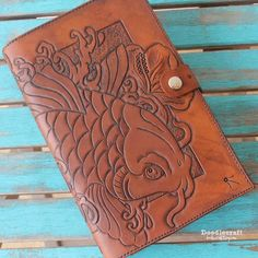 Leather Tooled Book Cover with Koi and Hibiscus! Tandy Leather Book Cover kit and about 12 hours of work! Dark brown antique stain and neatsfoot oil! Looks amazing! Tandy Leather, Leather Art, Leather Books, Tooled Leather, Leather Jewelry, Diy Leather Goods, Leather Gifts, Leather Carving, Larp