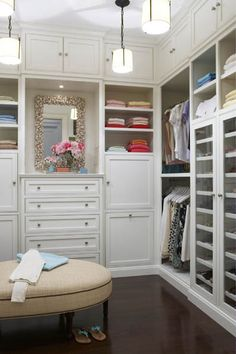 This luxurious closet take advantage of the high ceilings with storage that goes all the way to the ceiling. Photography by Michael Partenio