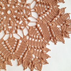 Copper Doily By Artistic NeedleWork When I first started making this piece I thought, what the heck, this is never going to work out. I was expecting the leaf pattern to be apparent. That was just NOT the case early on. And I choose a copper colored thread for that reason! It was