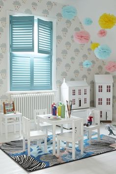 Looking for playroom window dressing ideas? These playful pastel blue window shutters are a fun addition to any nursery, playroom or children's room decoration
