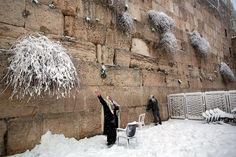 Israel, Jerusalem, Sunday, February 22, 2015: white front of the Wailing Wall in Jerusalem. In the night 25 inches fell new snow.