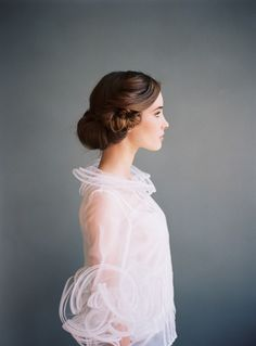 Looks like a Downton Abbey hair do...great for a wedding.