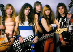 Maiden clash all over the place. Note this incredibly rare shot of Steve Harris without a monitor attached to his left foot.