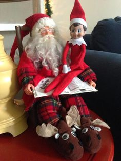 Elf on the Shelf sitting on santas lap at Seasons by Design specialty shop, 2605 Ford Drive, New Holstein, WI 53061.       920-898-9081 Seasonsbydesigngifts@yahoo.com  Follow us on Facebook