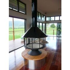 Experience the remarkable visual effect offered by Alpine Imperial Carousel wood fired heater. Enjoy the rich radiant heat that will warm to the toes. Radiant Heat, Visual Effects, Carousel, Firewood, Backyard, Ceiling Lights, Lighting, House, Fireplaces