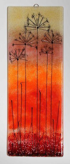 Amber and orange seed head panel #fusedglass #artglass #seedheads #wallart www.firedcreation...