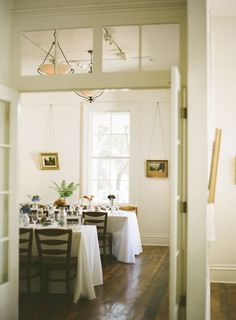 I'm totally digging the windows above the door, hardwood floor and old-fashioned picture-hanging job.