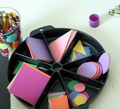 shape collage. give child a bunch of paper shapes, sheet of paper and a glue stick - good intro to shapes