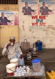 Drinking free coffee from a local politician, Zanzibar, Tanzania