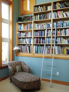 Not this shade of blue, but gives idea of blue with natural wood trim.  LOVE the bookcase!