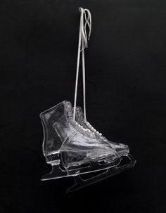Adel Abdessemed. 1 Pair of Skates, 2010. Hand-blown glass. Installed approx.: 261/2 x 13 x 6 inches (67.3 x 33 x 15.2cm). Left: 10 x 11 x 31/8 inches (25.4 x 27.9 x 7.9cm). Right: 101/4 x 113/8 x 3 inches (26 x 28.9 x 7.6cm).    SOURCE: darksilenceinsuburbia