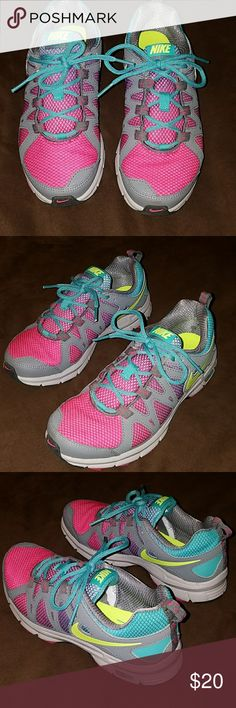 Nike Air Trail sneakers Women's size 6.5, hiking/cross training sneakers from Bike. Gray with pink/purple/blue hombre and neon yellow accents. They've been worn once and are in perfect shape... just too small for me. So cute though! Nike Shoes Sneakers