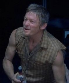 Norman Reedus aka Daryl Dixon 'The Walking Dead'.  Look @ those ARMS!