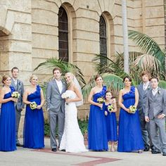 Royal Blue and Grey...love the grey on the groomsmen and blue on the bridesmaids; purple flowers to seal the deal