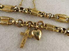 Engraved 9K gold antique Victorian charm bracelet with cross and heart, in original box. From Blackwicks of London