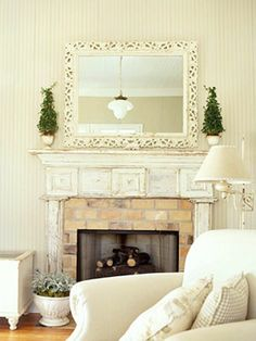 Another fireplace decorating idea, the topiaries would look nice at Christmas