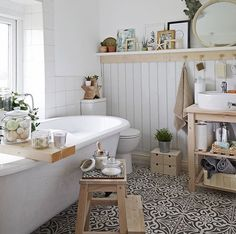 spa feel: natural woods, fresh plants, and jars filled with scrubs and oils