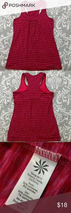 "Athleta racer back pink/gray stripe tank Athleta striped tank in pink tones Racer back  Size XS Built in padded bra 24.5"" in length from shoulder to hem  Pre-owned, no flaws, great condition Athleta Tops Tank Tops"