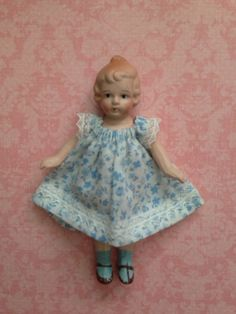 Tiny Vintage Bisque Dollhouse Doll in Blue