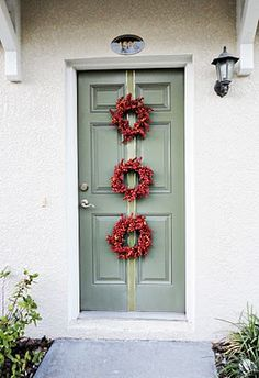 I need something that goes down the middle of the door since I have to long windows on each side.  DIY Door Wreaths