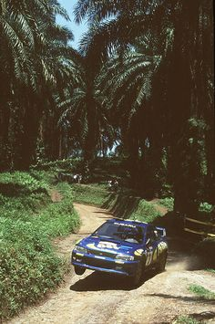Subaru Impreza WRC97 of Kenneth Eriksson at 1997 Rally Indonesia -- now THIS is the way to vacation!