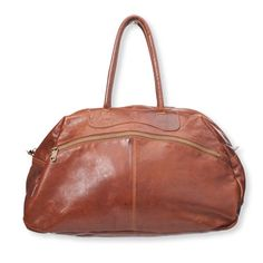 On the Road Bag - Arhaus Jewels. Sturdy leather in rich Cognac gives our roomy overnighter a touch of class. With a flat bottom, rolled handles, brass hardware, and contrasting topstiching. Featuring an exterior zippered pocket, zippered opening, interior zippered pocket and fabric lining. 23 inches long, 13.5 inches high, 10 inches wide, handles 20 inches long & 9 inch drop