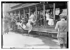 Getting on the street car, NYC, 1910